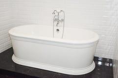 Luxury modern bath tub in contemporary house bathroom. Luxury modern bath tub in contemporary home bathroom stock photo