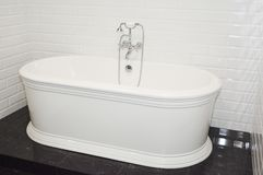 Luxury modern bath tub in contemporary house bathroom. Luxury modern bath tub in contemporary home bathroom royalty free stock photo