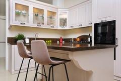 Luxury modern beige kitchen interior royalty free stock photos