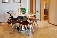 Luxury modern dining room. Dining room with  wood table, four wooden chairs,  and  natural wood floor in a luxury villa Stock Photography