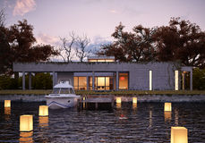Luxury modern house on water at sunset. royalty free stock photography