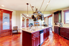 Luxury modern kitchen room with mahogany storage combination . Royalty Free Stock Photos