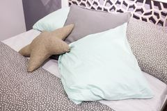 Luxury modern style bedroom,  decorative pillow in the form of a star. Royalty Free Stock Photo