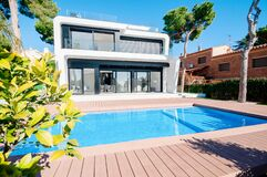 Free Luxury Modern White House With Large Windows Overlooking A Mediterian Landscaped Garden With Palm Trees And  Blue Swimming Pool. Royalty Free Stock Photo - 175282275
