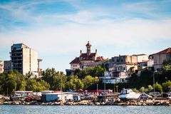 Luxury  modern yachts and motor boats. Docked in sea port in a Constanta old town stock photo