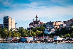 Luxury  modern yachts and motor boats. Docked in sea port in a Constanta old town royalty free stock photography