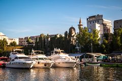 Luxury  modern yachts and motor boats. Docked in sea port in a Constanta old town royalty free stock images