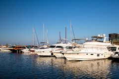 Luxury  modern yachts and motor boats. Docked in sea port in a Constanta old town stock photography
