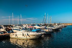 Luxury  modern yachts and motor boats. Docked in sea port in a Constanta old town royalty free stock image