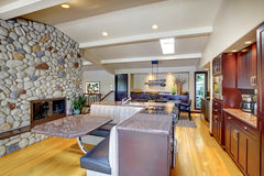 Luxury mohogany Kitchen with modern furniture and stone fireplace. Stock Photography