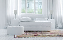 Luxury monochromatic white bedroom interior Stock Images