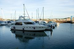 Luxury Motor Yacht. Luxury motor boat moored in a marina stock photography