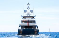 Luxury motor yacht back side sails away royalty free stock images
