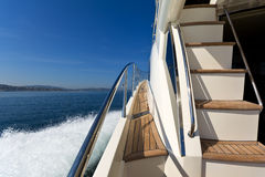 Luxury motor yacht. On-board shot of a luxury motor yacht cruising the sea Stock Image
