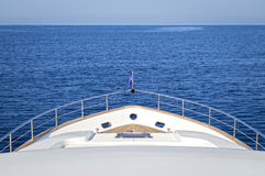 Luxury motor yacht. Bow of a luxury motor yacht cruising the blue sea Stock Photos