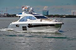 Luxury Motor Yacht Cruising on the Florida Intra-coastal Waterway off Miami Beach Royalty Free Stock Images