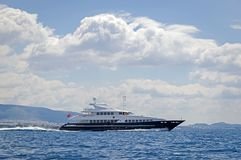 Luxury motor yacht cruising the sea stock photography