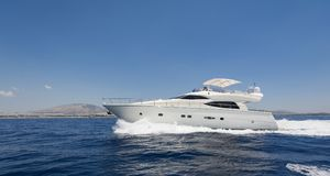Luxury motor yacht at full speed. Shot of a luxury motor yacht cruising at full speed Royalty Free Stock Photography