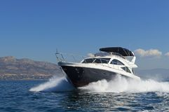 Luxury motor yacht at full speed. Shot of a luxury motor yacht cruising at full speed Royalty Free Stock Photo
