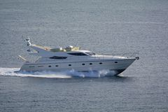 Luxury motor yacht at full speed. Shot of a luxury motor yacht cruising at full speed Stock Photo
