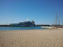 Luxury motor yacht in a marina of Franch riviera. Luxury motor yacht in a marina of Italien riviera. Ostia maritime town Stock Photo