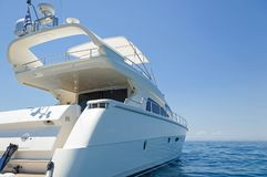 Luxury motor yacht on mooring. View of a luxury motor yacht on mooring at the Aegean sea, Greece stock photography