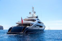 Luxury motor yacht, rear view, sailing on the sea royalty free stock image