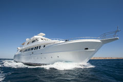 Luxury motor yacht at sea. Large luxury motor yacht under way out at sea Royalty Free Stock Photo