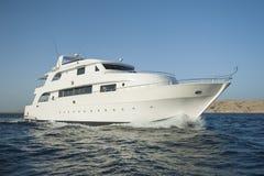 Luxury motor yacht at sea royalty free stock photo