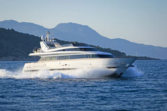 Luxury motor yacht. Shot of a luxury motor yacht cruising the Aegean sea, Greece Stock Photography