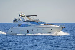 Luxury motor yacht. Shot of a luxury motor yacht cruising the Aegean sea, Greece royalty free stock photography
