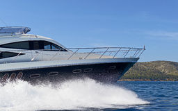 Luxury motor yacht. Shot of a luxury motor yacht cruising at full speed Stock Photos
