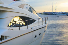 Luxury motor yacht. A view of the side of a luxury motor yacht at sunset in a greek marina stock image