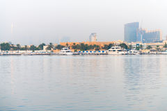 Luxury Motor Yachts Docked along a Major Waterway in Dubai Royalty Free Stock Photography