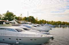 Luxury motor yachts. On the dock stock photography