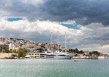 Luxury motorboat at the dock.Marina Zeas, Piraeus,Greece. Luxury yacht under heavy clouds at the dock. Marina Zeas, Piraeus,Greece stock image