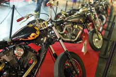Luxury motorcycles at exhibition Stock Photos