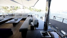 Luxury motoryacht interior. Interior of luxury motoryacht or motor boat on a warm sunny summer day. Wealth, money and lifestyle concept. Leisure activity stock footage