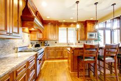 Luxury mountain home wood kitchen with island. Royalty Free Stock Images