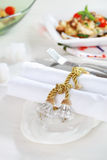 Luxury napkins with napkin ring. On the white tablet Stock Photography