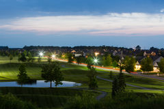 Luxury Neighborhood Bordering Golf Course at Dusk Royalty Free Stock Image