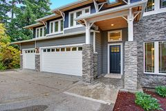 Luxury new construction home with stone veneer siding.