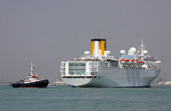 Luxury ocean cruise ship liner and barge Stock Photo