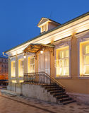 Luxury office building. A single storey building in classical palladio style with yellow walls and evening architectural lighting. Moscow, Russia Royalty Free Stock Photography