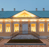 Luxury office building. A single storey building in classical palladio style with yellow walls and evening architectural lighting. Moscow, Russia Royalty Free Stock Photos