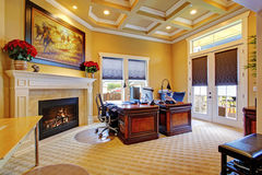 Luxury office room interior. With coffered ceiling, fireplace and wood carved desks Royalty Free Stock Photos