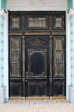 Luxury old brown wooden door with ornaments in building Stock Images