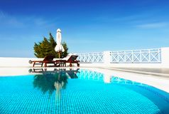 Luxury outdoor Pool,Travel, Vacation, Relaxation, Background. Luxury outdoor swimming pool. Travel, summer vacation or relaxation background. Turquoise, aqua Stock Images
