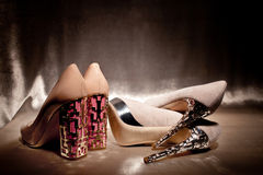 Luxury pairs glamour high heeled shoes on gold silk Royalty Free Stock Photo