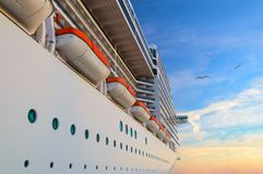 Luxury passenger ship cruise liner at sunrise royalty free stock photo